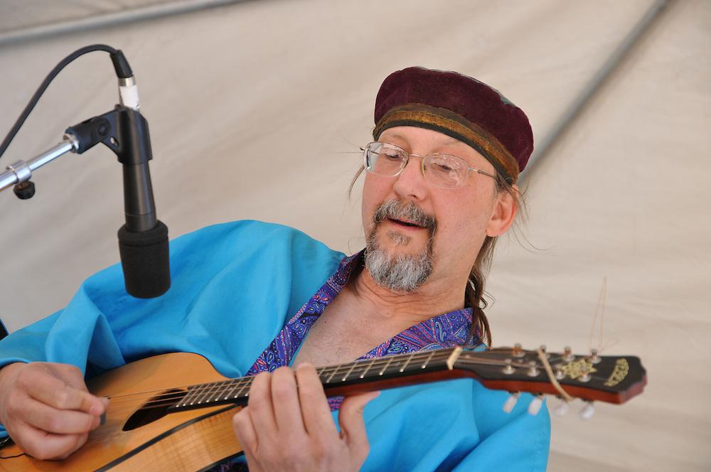 Mark Holdaway plays mandolin during Indigo Spirit concert at 2011 Tucson Folk Festival. Event photography by Martha Retallick.