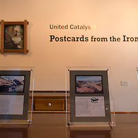 070214      Cayla Nimmo<br /> <br /> Previous Artists in Resident's, Steve Radosevich and Kim Garrison, display their &quot;Postcards form the Iron Camera&quot; show in the Painted Desert Inn at the Petrified Forest National Park in Arizona Wednesday morning.