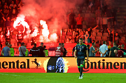 BELGRADE, SERBIA - Sunday, June 11, 2017: Wales' Chris Gunter looks dejected as Serbia score an equalising goal and supporters set off a red flare during the 2018 FIFA World Cup Qualifying Group D match between Wales and Serbia at the Red Star Stadium. (Pic by David Rawcliffe/Propaganda)