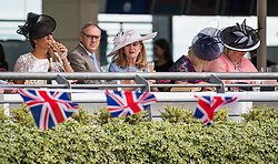 © Licensed to London News Pictures. 19/06/2018. London, UK.  Racegoers attend day one of Royal Ascot at Ascot racecourse in Berkshire, on June 19, 2018. The 5 day showcase event, which is one of the highlights of the racing calendar, has been held at the famous Berkshire course since 1711 and tradition is a hallmark of the meeting. Top hats and tails remain compulsory in parts of the course. Photo credit: Ben Cawthra/LNP