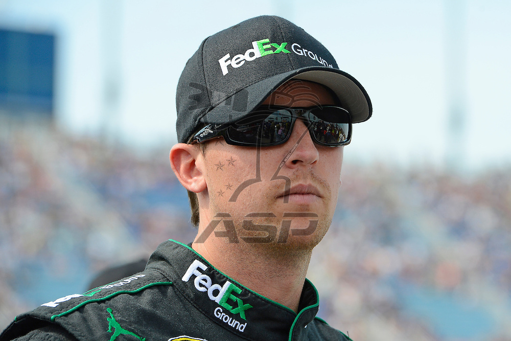 Joliet, IL - SEP 16, 2012: Denny Hamlin (11) stands on pit row before the Geico 400 at the Chicagoland Speedway in Joliet, IL.