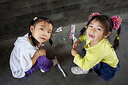 Panjiayuan weekend market. Two little ladies.