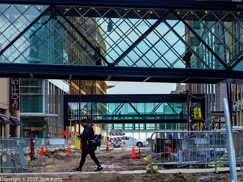 03 MAY 2017 - MINNEAPOLIS, MN: Skyways over Nicollet Mall in downtown Minneapolis. The skyways are enclosed pedestrian overpasses that connect downtown buildings. The Minneapolis Skyway was started in the early 1960s as a response to covered shopping malls in the suburbs that were drawing shoppers out of the downtown area. The system grew sporadically until 1974, when the construction of the IDS Center and its center atrium, called the Crystal Court, served as a hub for the downtown skyway system. There are 8 miles of skyways, connecting most of the downtown buildings from Target Field (home of the Minnesota Twins) to US Bank Stadium (home of the Minnesota Vikings). In the last five years many upscale downtown apartment buildings and condominium developments have been added to the system, allowing downtown residents to live and work downtown without going outside.    PHOTO BY JACK KURTZ