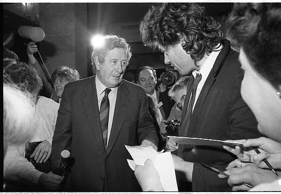 """Bob Geldof Receives F.A.O.Medal..1986..16.10.1986..10.16.1986..16th October 1986..The highlight of Gorta's 21st anniversary World Food Day was the presentation of an F.A.O.(Food and Agriculture Organisation of the United Nations) to Bob Geldof. The medal was presented by An Taoiseach,Dr Garret Fitzgerald. The medal was in recognition of Bob's efforts and contribution towards famine relief in the Third World. The ceremony took place in The Berkeley Court Hotel in Dublin...In the midst of the media scrum, Bob is pictured meeting An Taoiseach,Dr Garret Fitzgerald. Bob is signing copies if his book, """"Is That It""""."""