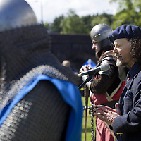 Poet and Guardians trustee, Paraig MacNeil, speaks to the crowd.<br /> <br /> <br /> BRAVEHEART HEROES, WILLIAM WALLACE AND ANDREW DE MORAY, FINALLY HONOURED AT STIRLING BRIDGE BATTLE SITE AS SALTIRE RAISED FOR FIRST TIME IN OVER 700 YEARS<br /> <br /> Friday 29th May, 2015<br /> <br /> IT&rsquo;S TAKEN more than 700 years but today, the two heroes at the centre of one of the most important battles in Scottish history have been jointly honoured at the spot where they both led an outnumbered Scottish army to victory against the English.<br /> The formal unveiling ceremony at Stirling Bridge today (Friday 29th May), of three lecterns made of traditional Scottish whinstone dedicated to the memory of William Wallace and Andrew de Moray,&nbsp;at site of the historic victory at Battle of Stirling Bridge.<br /> At a special ceremony attended by Andrew de Moray&rsquo;s direct descendant, the Earl of Moray, and Stewart Maxwell, MSP, convener of the Scottish Parliament&rsquo;s Education and Culture Committee, the memorials were formally unveiled.Mr Maxwell opened the event and after the dedication, together with the Earl of Moray, they raised the Saltire together at the site of the Battle of Stirling Bridge. This is the first time in over 700 years that the Saltire has flown at Stirling Bridge. The flag will now become a permanent fixture at the site of the Battle.<br /> John Stuart, the current Earl of Moray, said of his illustrious kinsman: &ldquo;I am delighted that Andrew de Moray is finally, after 700 years, to have the recognition he deserves. The Guardians of Scotland have put a huge amount of time and effort into the lecterns, which are a very fitting tribute to one of Scotland's greatest patriots.&quot;<br /> The victory represented a key moment in the Scottish Wars of Independence. Eminent Scots historian, Sir Tom Devine, recently described the battle as being &lsquo;second in importance only to Bannockburn in the Wars of Independence&rsquo;.&nbsp;<br /> It is the first time the two men have been given equal prominence. One stone tells the story of Andrew de Moray while an