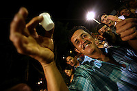 A man prepares to take a shot of the local liquor during a party in the town plaza in Leiva, a small remote village in the southern Colombian state of Nariño, on Sunday, June 24, 2007. (Photo/Scott Dalton)