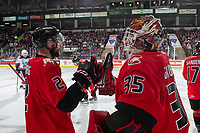 KELOWNA, BC - DECEMBER 30: Cole Moberg #2 and Mitchell Kohner #25 of the Prince George Cougars fist bump to celebrate a second period goal against the Kelowna Rockets  at Prospera Place on December 30, 2019 in Kelowna, Canada. (Photo by Marissa Baecker/Shoot the Breeze)