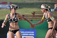 STARE JABLONKI POLAND - July 4: Doris Schwaiger /1/ and Stefanie Schwaiger of Austria in action during Day 4 of the FIVB Beach Volleyball World Championships on July 4, 2013 in Stare Jablonki Poland.  (Photo by Piotr Hawalej)