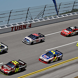 April 17, 2011; Talladega, AL, USA; NASCAR Sprint Cup Series driver Jimmie Johnson (48), \s24, Dale Earnhardt Jr. (88), Mark Martin (5), Landon Cassill (09) and Paul Menard (27) take turn four during the Aarons 499 at Talladega Superspeedway.   Mandatory Credit: Derick E. Hingle