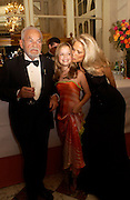 Dina de Laurentiis and her parents,  Dino  and Martha de Laurentiis, The  Thirteenth Annual Crillon Haute Couture Ball. Paris,  29 November 2003. © Copyright Photograph by Dafydd Jones 66 Stockwell Park Rd. London SW9 0DA Tel 020 7733 0108 www.dafjones.com