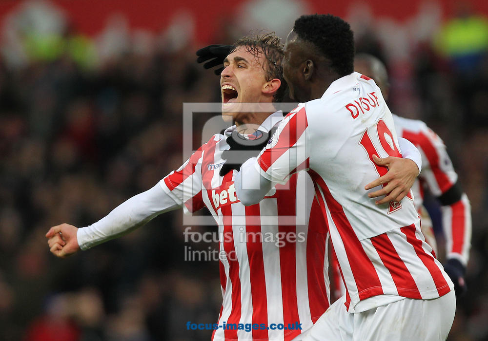 Marc Muniesa of Stoke City celebrates with Mame Biram Diouf after scoring the second goal against Burnley during the Premier League match at the Bet 365 Stadium, Stoke-on-Trent.<br /> Picture by Michael Sedgwick/Focus Images Ltd +44 7900 363072<br /> 03/12/2016