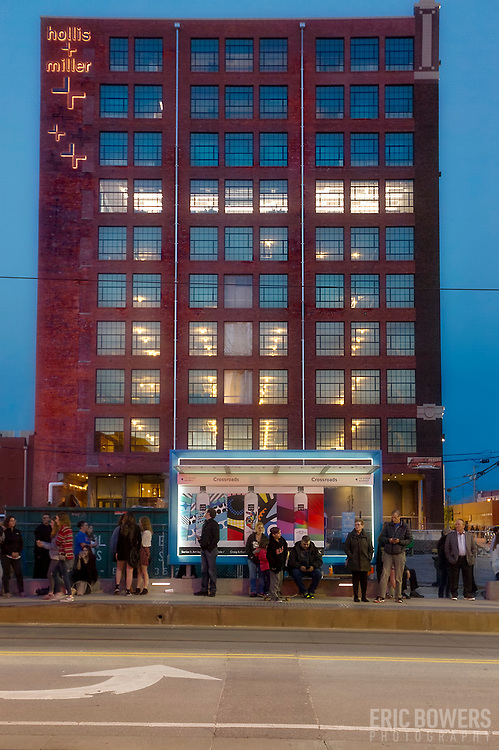 Renovation of Corrigan Building near 20th & Main; Kansas City, Missouri - with streetcar stop in foreground.