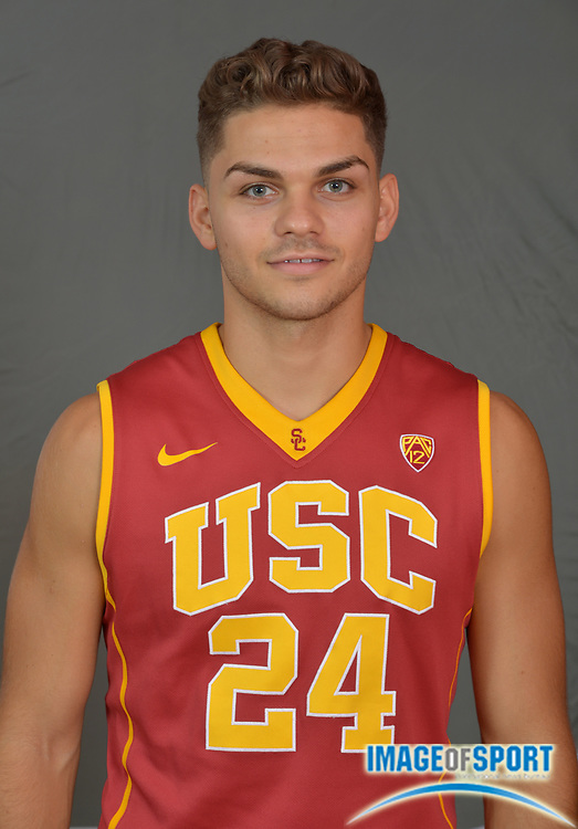 Sep 25, 2015; Los Angeles, CA, USA: Southern California Trojans guard Kurt Karis (24) poses at media day at the Galen Center.