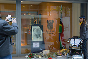 Brussels Belgium 6th December 2013. At the South African Embassy in Brussels people gather, Nelson Mandela died just yesterday.Man takes a picture of a woman with the tribute to mandela