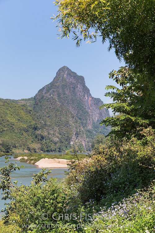 A beautiful view of the limestone mountains along the Nam Ou (Ou River) in Luang Prabang Province, Loas.