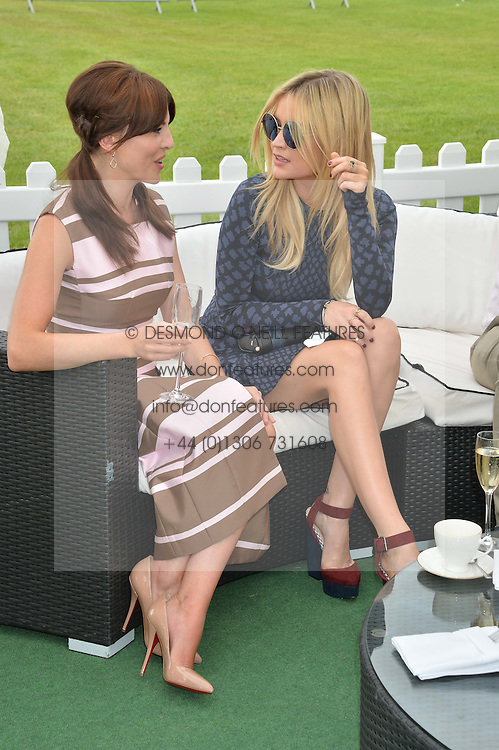 Left to right, OPHELIA LOVIBOND and LAURA WHITMORE at the St.Regis International Polo Cup at Cowdray Park, Midhurst, West Sussex on 17th May 2014.