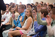 Sophia Steyns, center, and other new students listen during the Ohio University College of Business Freshman Convocation in Nelson Commons on Aug. 23, 2014. Photo by Lauren Pond