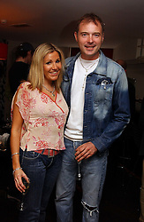 "JOHN LESLIE and ANGELA STEWART at a party to celebrate the publication of a ""Diary of A C List Celebrity"" by Paul Hendy held at Bar 19/21 Soho House, 21 Old Compton Street, London W1 on 13th July 2004."