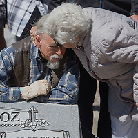 Ramona Muñoz gives her son, Fernando Muñoz, a kiss on the forehead during their family reunion to put a headstone on the grave site of Fernando and Dolores Muñoz at Hillcrest Cemetery in Gallup Saturday. Fernando, from Los Angeles, has been looking in to his family history and found the unmarked grave of his grandparents during a previous trip to Gallup.