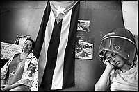 Two women are seen in a beauty parlor on November 2000 in Havana, Cuba. By subtly influencing people's moods and appealing to their sense of patriotism, after more than four decades, communist government in Cuba still counts with the support of the majority. (Photo/Cristobal Herrera)