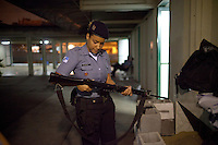 Police Pacification Unit (UPP) officer Mariana Gomes prepares for patrol in Complexo do Caju, a complex of a newly pacified favelas in the North Zone, Rio de Janeiro, Brazil, on Saturday, April 27, 2013. <br />