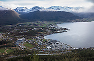 The town of Sandane, Norway, is seen from the Utsikten viewpoint on Monday, May 13, 2013. The town is at at the end of Gloppenfjorden, which leads to Nordfjord. The toll road leading to the overlook continues up  to Gloppestadstøylen and Austrheimstøylen (rustic mountain cabins). (© 2013 Cindi Christie/Cyanpixel)