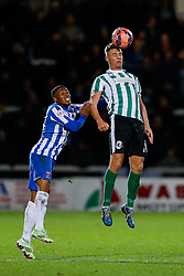 Sidney Schmeltz of Hartlepool United and Alex Nicholson of Blyth Spartans compete in the air - Photo mandatory by-line: Rogan Thomson/JMP - 07966 386802 - 05/12/2014 - SPORT - FOOTBALL - Hartlepool, England - Victoria Park - Hartlepool United v Blyth Spartans - FA Cup Second Round Proper.