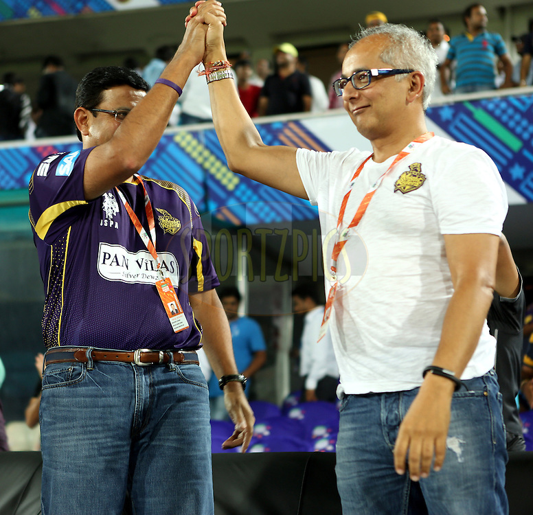 Venky Mysore and Jay mehta co -owner of Kolkatta Knight Riders celebrates after winning the  match 7 of the Oppo Champions League Twenty20 between the Kolkata Knight Riders and the Lahore Lions held at the Rajiv Gandhi Cricket Stadium, Hyderabad, India on the 21st September 2014<br /> <br /> Photo by:  Sandeep Shetty / Sportzpics/ CLT20<br /> <br /> <br /> Image use is subject to the terms and conditions as laid out by the BCCI/ CLT20.  The terms and conditions can be downloaded here:<br /> <br /> http://sportzpics.photoshelter.com/gallery/CLT20-Image-Terms-and-Conditions-2014/G0000IfNJn535VPU/C0000QhhKadWcjYs