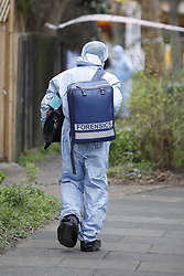 © Licensed to London News Pictures. 07/03/2019. London, UK. Forensics officers work at a property in Kew, West London, where the body of a woman was discovered by police in a shallow grave. Laureline Garcia-Bertaux, 34, from Richmond, was reported missing after she did not turn up for work on Monday, 4 March. . Photo credit: Peter Macdiarmid/LNP