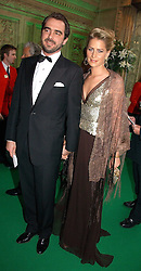 PRINCE NICKOLAS OF GREECE and close friend TATIANNA  at the NSPCC's Dream Auction held at The Royal Albert Hall, London on 9th May 2006.<br />