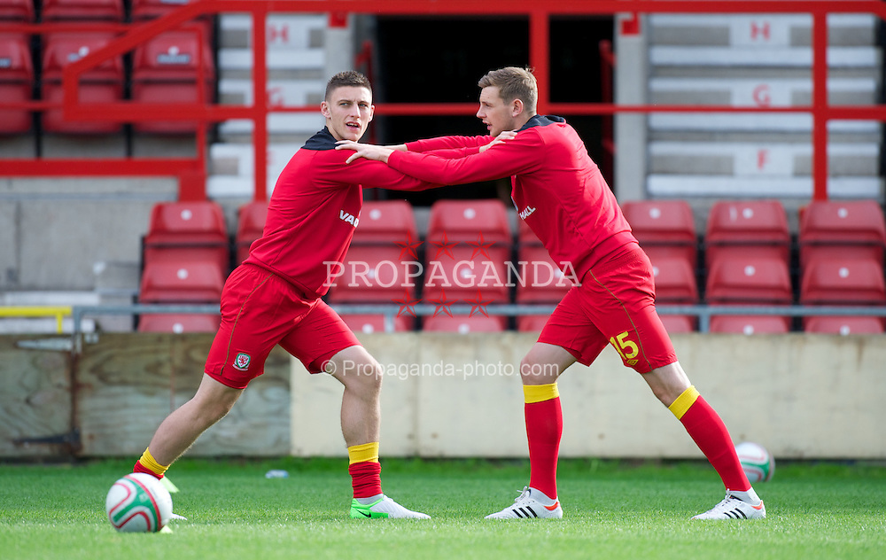 WREXHAM, WALES - Wednesday, August 15, 2012: Wales' xxxx and Ashton Taylor warm-up before the UEFA Under-21 Championship Qualifying Round Group 3 match against Armenia at the Racecourse Ground. (Pic by Dave Richards/Propaganda)
