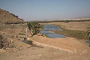 Sahara desert, Zagora, Morocco Irrigation channel of canalised river, Sahara desert, Zagora, Morocco, north Africa