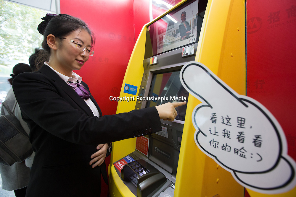 NANJING, CHINA - NOVEMBER 16: (CHINA OUT) <br /> <br /> A face you can bank on: China launches the country's first cash machines using facial recognition technology&nbsp;<br /> <br /> China could soon wave goodbye to bank cards as it rolls out the first of its facial recognition enabled ATMs.<br /> The clever machines were recently made available to customers of China Merchants Bank in the cities of Shenzhen, Nanjing and Qingdao, with more planned for the future.<br /> It is the first time the technology has been made available for public use in China since the technology was unveiled earlier this year<br /> A total of 10 facial recognition ATMs were introduced to China Merchant Bank branches in cities around the country this month - the first of its kind in the country.<br /> Some of the machines were Minions-themed while others were plain.&nbsp;<br /> They allow users to access their bank accounts by scanning their faces, effectively making bank cards redundant.<br /> There are obvious security concerns over the use of the machines and as an added security, users must input their telephone numbers as well as a password.<br /> Staff claims that the machine is even able to distinguish between twins as the visual image processing technology used takes its profile from several parts of the face.<br /> <br /> This has been successfully proved during the product testing stage of the machine.<br /> They also claim a small variation in appearance, including wearing glasses or make-up, shouldn't affect the efficiency of the system.<br /> However, major plastic surgery would require customers to update their photograph used on their identification cards.&nbsp;<br /> The technology eliminates the use of cards. With the average speed of a cash withdrawal reportedly just 42 seconds, it could also speed up the process.<br /> However, users are restricted to a daily withdrawal limit of 3,000 Yuan (&pound;300), compared to conventional methods that allow users to withdrawn up to 