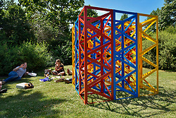 "© Licensed to London News Pictures. 05/07/2017. London, UK. ""Summertime - The Regents Park"", 2017, by Rasheed Araeen.  The Frieze Sculpture festival opens to the public in Regent's Park.  Featuring outdoor works by leading artists from around the world the sculptures are on display from 5 July to 8 October 2017.  Photo credit : Stephen Chung/LNP"
