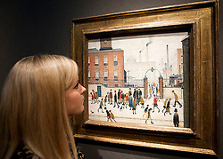 © Licensed to London News Pictures. 10/12/2012. London, UK. A Christie's employees views 'At the Mill Gate' (1945) (est. GB£1,200,000-1,800,000) by Laurence Stephen Lowry at a press view held at the auction house's King Street Premises in London today (10/12/12). The evening auction, entitled 'Rule Britannia', and featuring over 185 lots by Britain's most influential modern artists, takes place on Wednesday the 13th Of December. Photo credit: Matt Cetti-Roberts/LNP