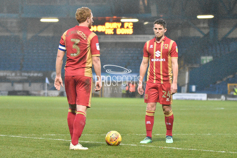 Milton Keynes Dons Defender, Dean Lewington (3) goal scorer and Milton Keynes Dons Midfielder, Jordan Houghton (24)  during the EFL Sky Bet League 2 match between Bury and Milton Keynes Dons at the JD Stadium, Bury, England on 12 January 2019.