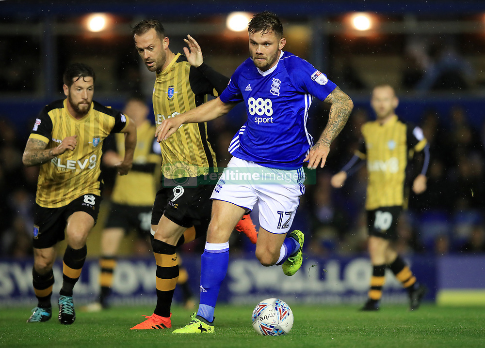 Birmingham City's Harlee Dean (right) and Sheffield Wednesday's Steven Fletcher battle for the ball