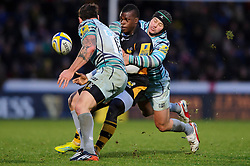 Wasps Winger (#11) Christian Wade is tackled by Leicester Full Back (#15) Mathew Tait during the second half of the match - Photo mandatory by-line: Rogan Thomson/JMP - Tel: Mobile: 07966 386802 25/11/2012 - SPORT - RUGBY - Adams Park - High Wycombe. London Wasps v Leicester Tigers - Aviva Premiership.