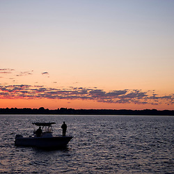A fishing boat at sunrise in the mouth of the Connecticut River in Old Saybrook, Connecticut.