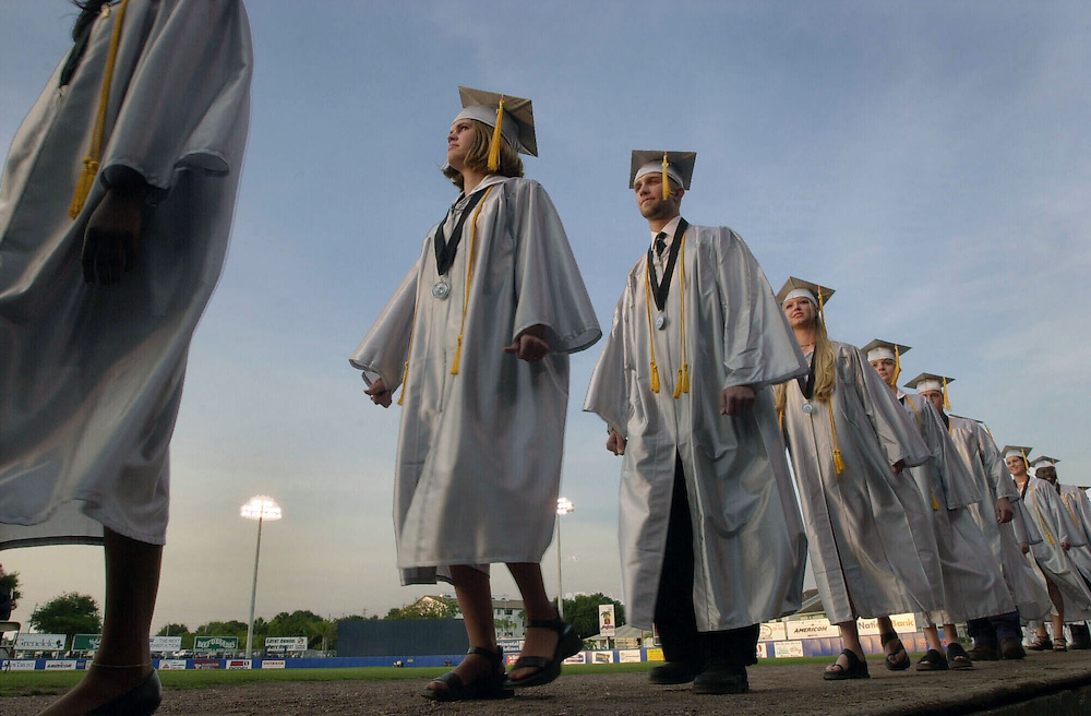 POLK LAKELAND,FL-POGRADS-5/17/00-Lake Region seniors walk during the commencement exercies May 17 at Chain O' Lakes Stadium.(staff/scott iskowitz)