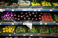 Variety of fruits and vegetables on display in grocery store