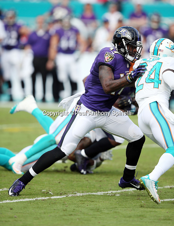 Baltimore Ravens wide receiver Jeremy Butler (17) blocks Miami Dolphins cornerback Brice McCain (24) during the 2015 week 13 regular season NFL football game against the Miami Dolphins on Sunday, Dec. 6, 2015 in Miami Gardens, Fla. The Dolphins won the game 15-13. (©Paul Anthony Spinelli)