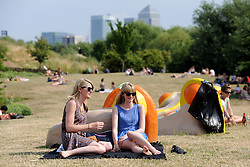 © Licensed to London News Pictures. 14/07/2013. Mile End Park, London. Londoners enjoy the sun in mile End Park, East London. Photo credit : LNP