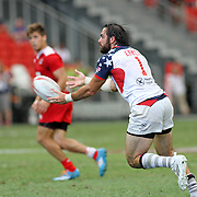USA Eagle and NFL New England Patriot, Nate Ebner, receives a pass vs Russia at the Singapore 7's, day 2, Singapore National Stadium, Singapore.  Photo by Barry Markowitz, 4/17/16