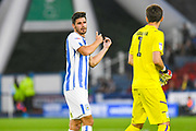Christopher Schindler of Huddersfield Town (26) and Kamil Grabara of Huddersfield Town (1) during the EFL Sky Bet Championship match between Huddersfield Town and Derby County at the John Smiths Stadium, Huddersfield, England on 5 August 2019.