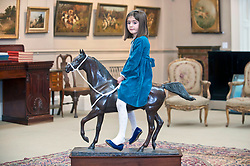 Clementine (4) from Edinburgh with a bronze of the Arabian Stallion Twaig, expected to fetch in excess of &pound;10,000 when it goes under the hammer at Bonhams sporting auction in Edinburgh this week.<br /> <br /> &copy; Dave Johnston/ EEm