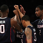 UConn players team bond before the Iowa State Cyclones Vs Connecticut Huskies basketball game during the 2014 NCAA Division 1 Men's Basketball Championship, East Regional at Madison Square Garden, New York, USA. 28th March 2014. Photo Tim Clayton