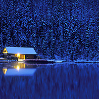 Boat house photographed in predawn light following light overnight snowfall.