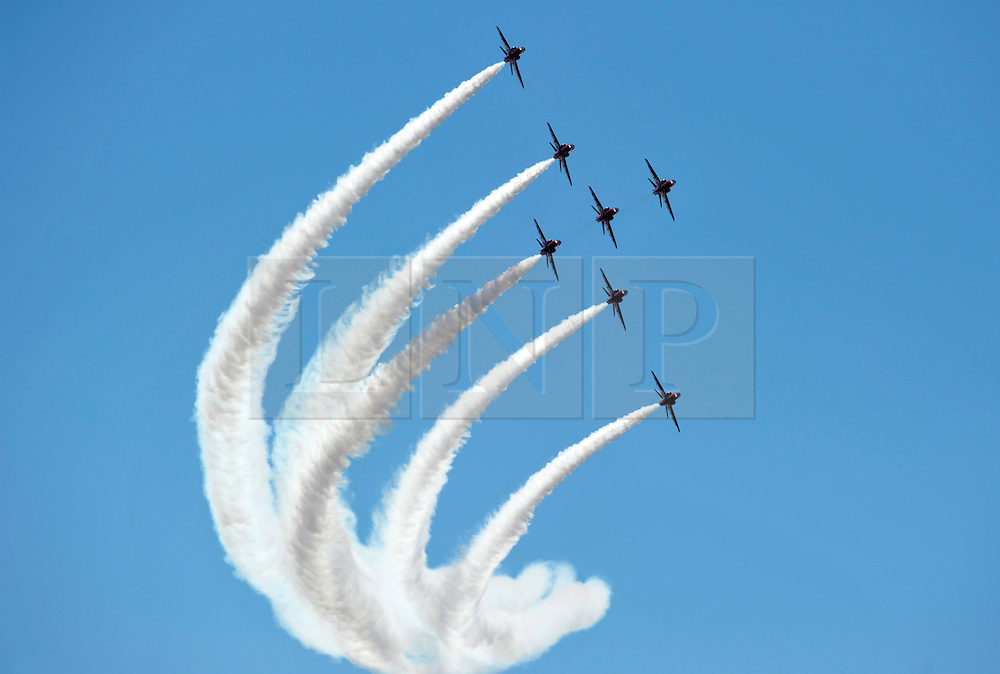 © Licensed to London News Pictures. 23/07/2012. Weston-super-Mare, Somerset, UK. The Red Arrows perform in an Airshow in the blue skies above Weston-super-Mare pier.  23 July 2012..Photo credit : Simon Chapman/LNP