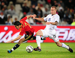 David Villa and Jay Demerit  during the Semi Final soccer match of the 2009 Confederations Cup between Spain and the USA played at the Freestate Stadium,Bloemfontein,South Africa on 24 June 2009.  Photo: Gerhard Steenkamp/Superimage Media.